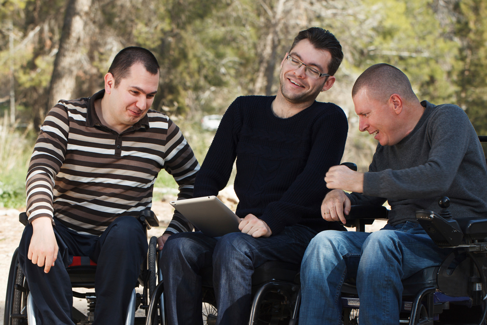 Three young men using wheelchairs at Gallagher
