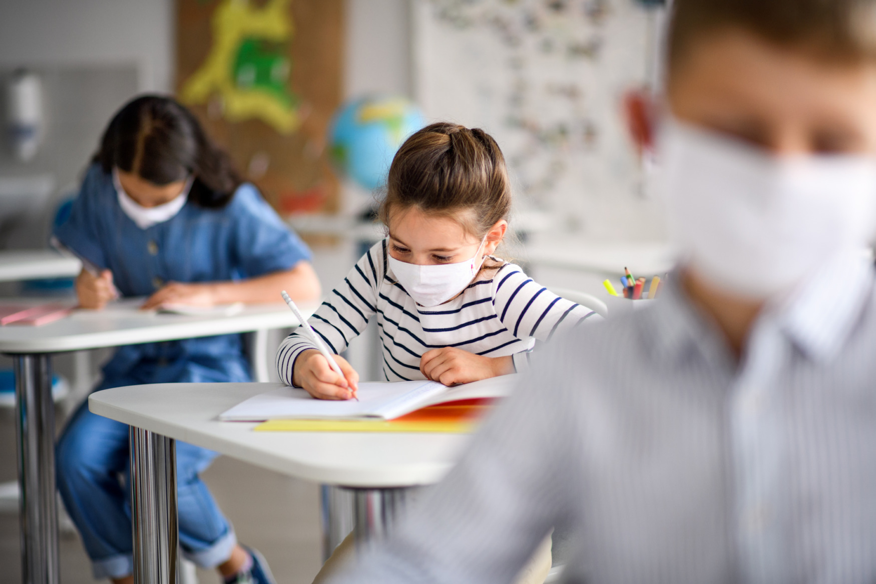 young students masked in school